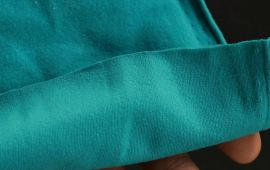 Vải thun poly 4 chiều màu ngọc đậm